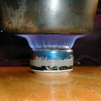 Pepsi-can stove lit.JPG