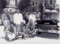 Délégation Scoute tunisienne à Alexandrie en juillet-août 1956.  Abdallah Zouaghi est le troisième homme debout en partant de la gauche. Debout de gauche à droite: Rachid Sfar, Abdelaziz Bel-Hadj Taieb, Abdallah Zouaghi, un accompagnateur égyptien, Azouz Rebai  (premier sous-secrétaire d'Etat à la jeunesse de la Tunisie récemment indépendante) puis un chef scout égyptien). Assis les chefs scout Abdelazir Triki, Taien Nouira et Abdelmajid A.