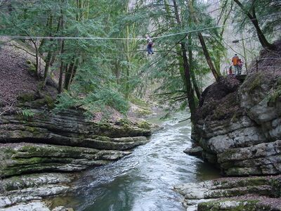 Rope bridge across the Swiss river Areuse near Lake Neuchâtel